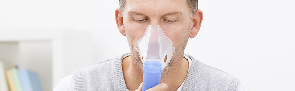 Man using oxygen equipment and nebulizer