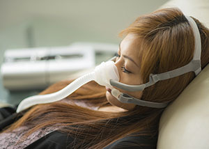 respiratory solutions for private patients - woman with respiratory device