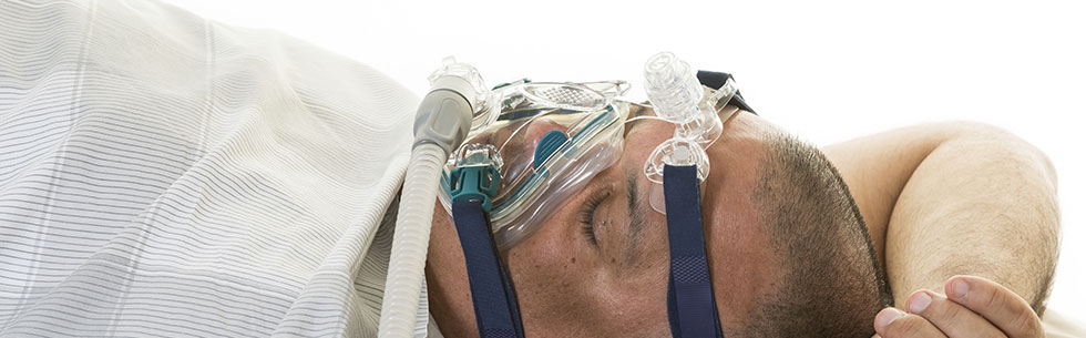 man using sleep apnea machine